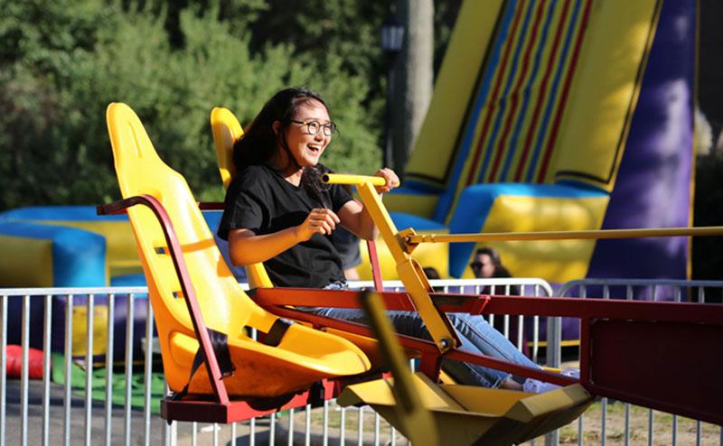 Student on carnival ride at 2017 Sizzlin September Street Fair