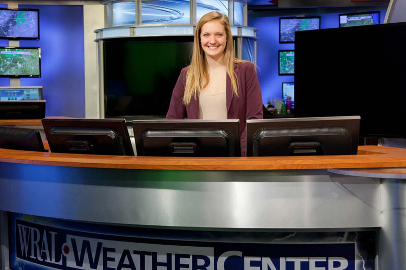Image of student at internship at WRAL weather center