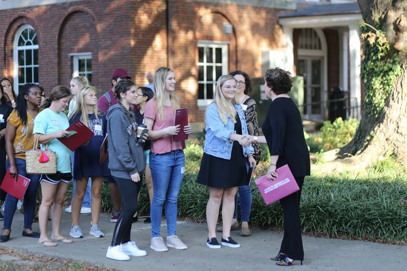 President Jo Allen greeting students at Meredith Open House
