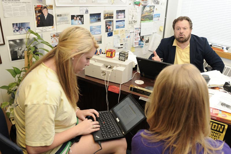 Communication Professor Doug Spero and Students in office