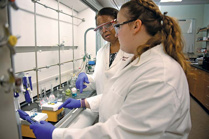 Dr. Powell and student in lab