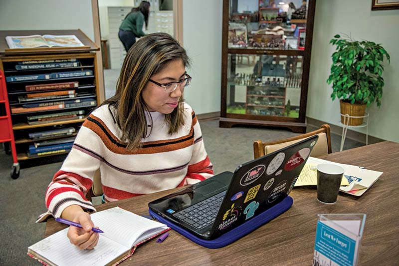 Student at computer in library