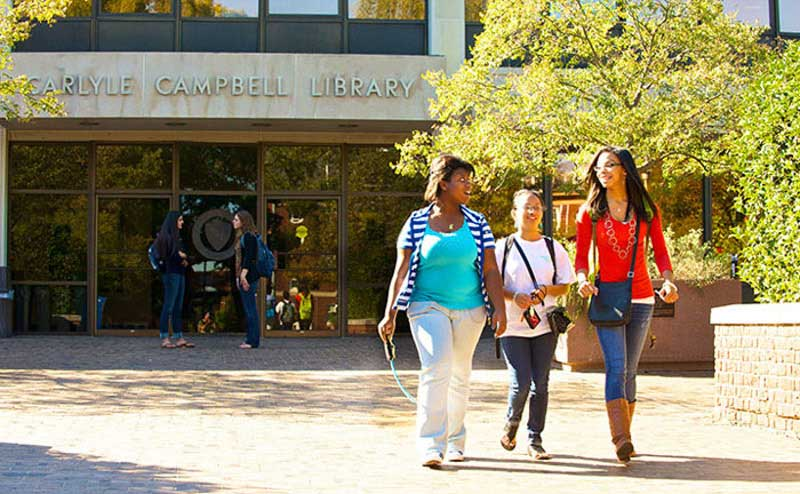 Students walking in front of library
