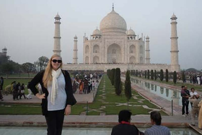 Taj Mahal at a distance with student posing