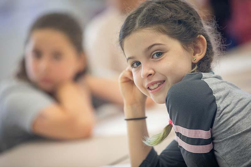 Latino Girl Smiling at Camera