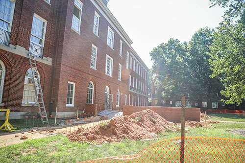 Exterior view of the back of Johnson Hall under construction