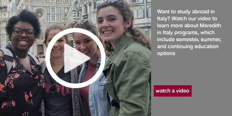 Students walking in Tuscan Country side with text to watch videos about the Meredith's Study Abroad in Italy Program