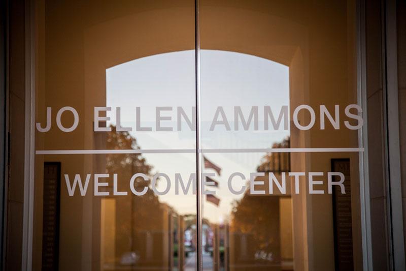 Front door of Johnson Hall with Jo Ellen Ammons Welcome Center printed on the glass doors