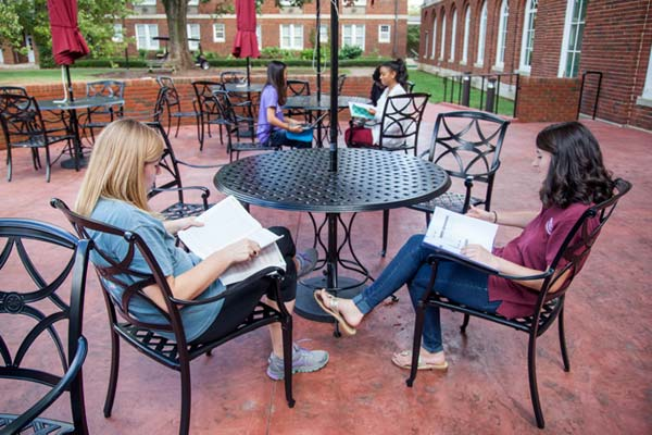 Students sitting at the patio outside of Johnson Hall