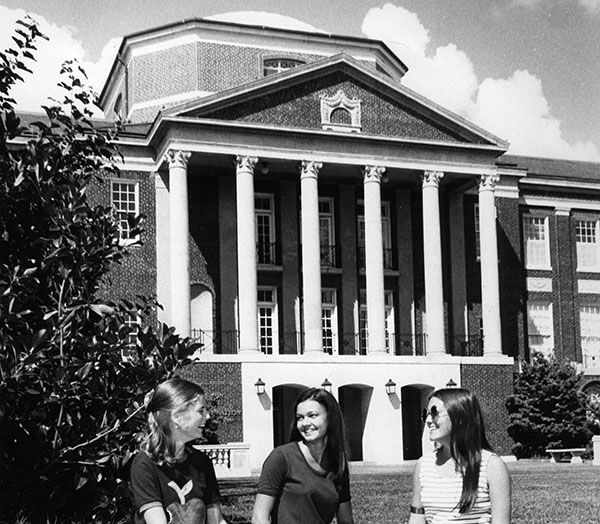 Students sitting outside of Johnson Hall