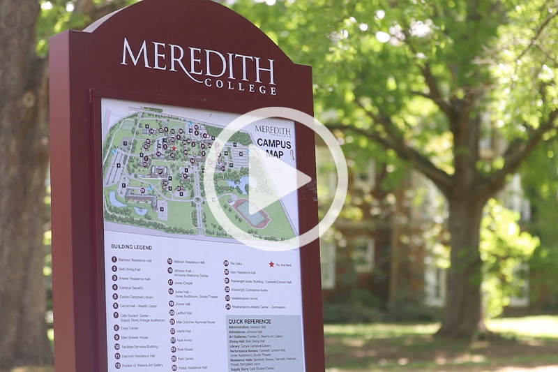 Click image of Meredith College Campus Map Sign with trees visible in background to watch movie in modal