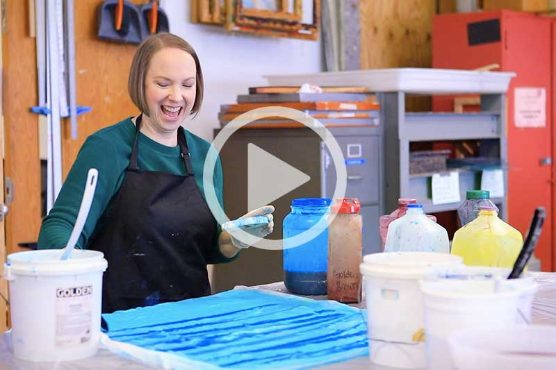 Click on image of Adult Student Painting in Art Studio to play video in modal