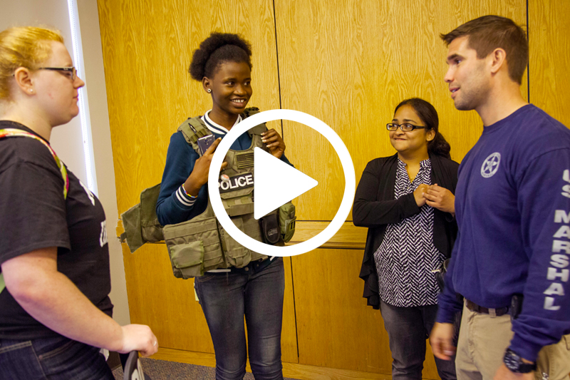 click on image of female students and detective to watch Criminology Video showing the strengths of the major