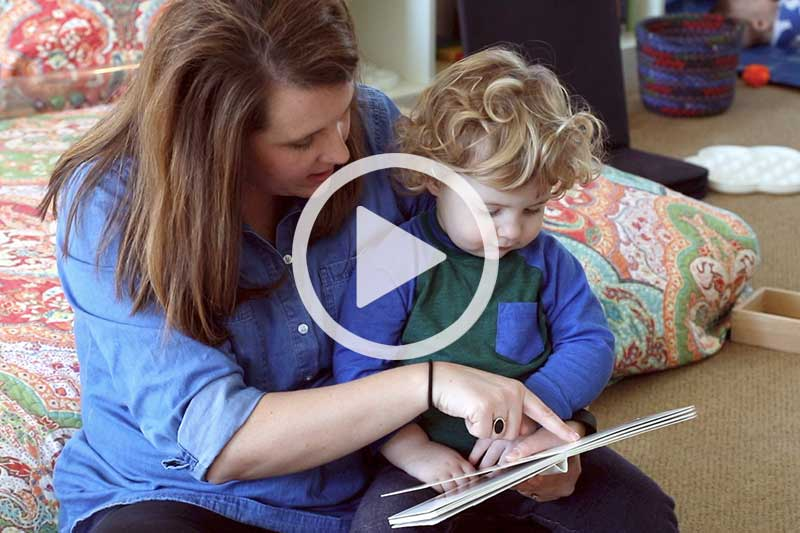Click image of mother reading to child to watch a video in modal explaining The Power of Picture Books