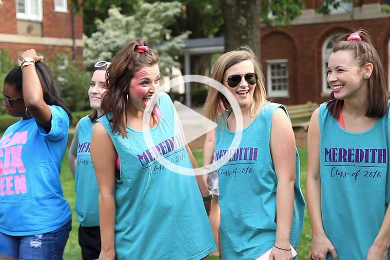 Click  on photo of students gathered in quad to view video in modal of Student Life at Meredith College