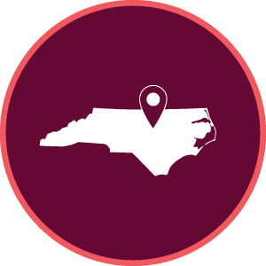maroon icon with an outline of north carolina and a mark where Raleigh is located