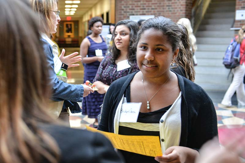Prospective Student talking to a faculty member