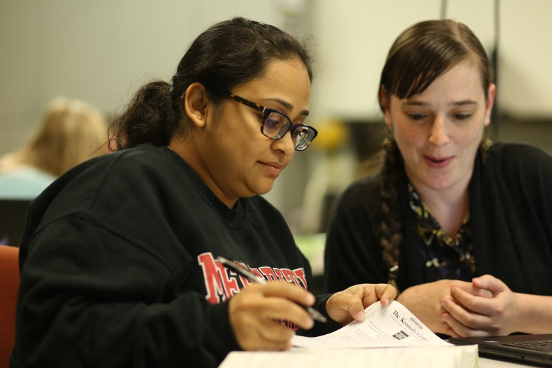 Image of two students studying.