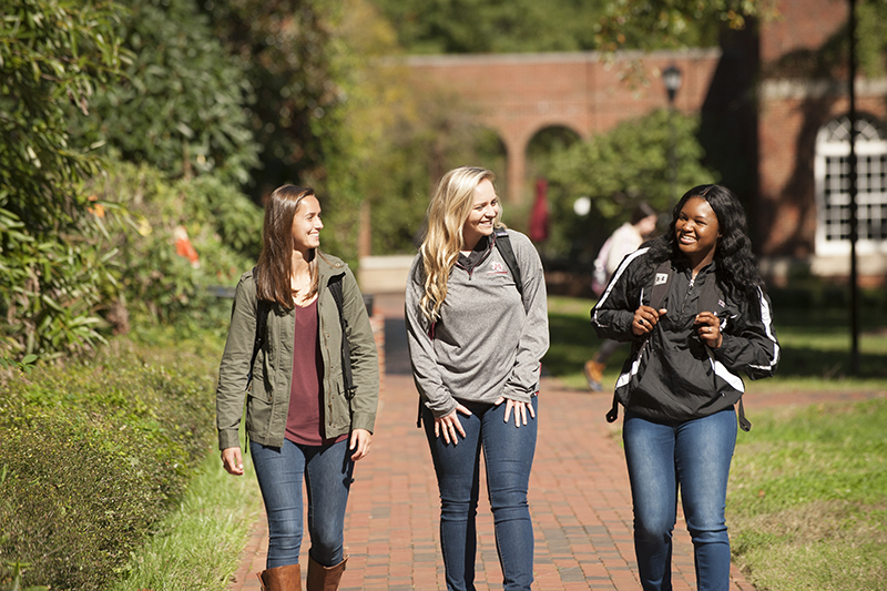 students walking on campus fall