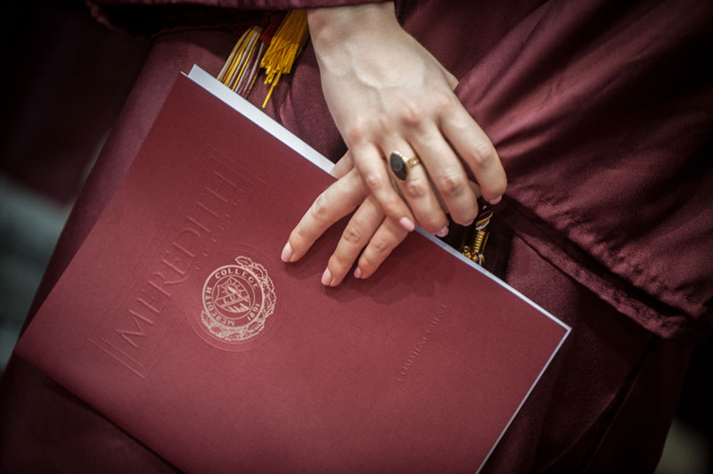 Hands holding diploma