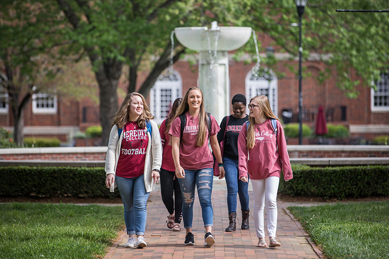 Students Walking in the campus quad with the fountain visible