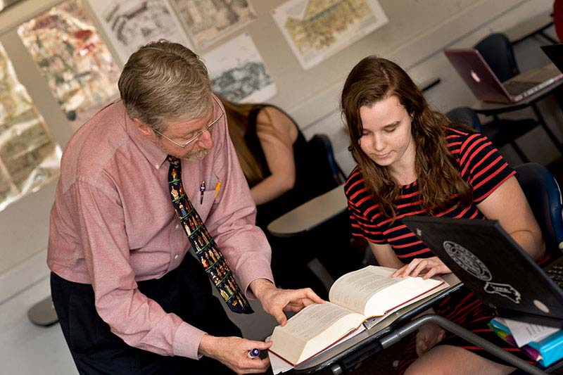 Professor of English Garry Walton with a student in his Shakespeare course