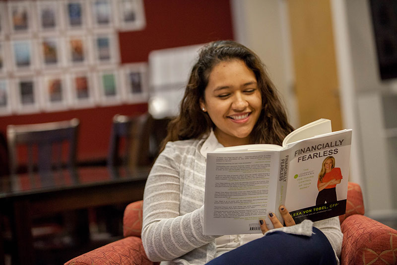 Student Reading Book in Cate Center