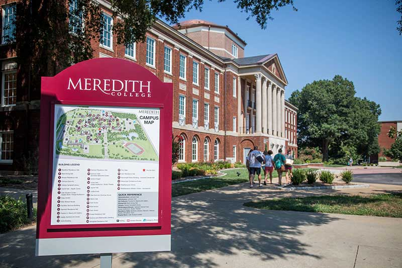 Image of Johnson Hall on Meredith's campus with campus map in foreground and the words Meredith College