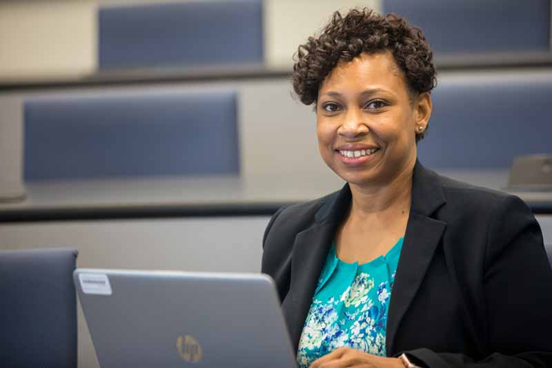 MBA alumna Candance Goins in front of her laptop.