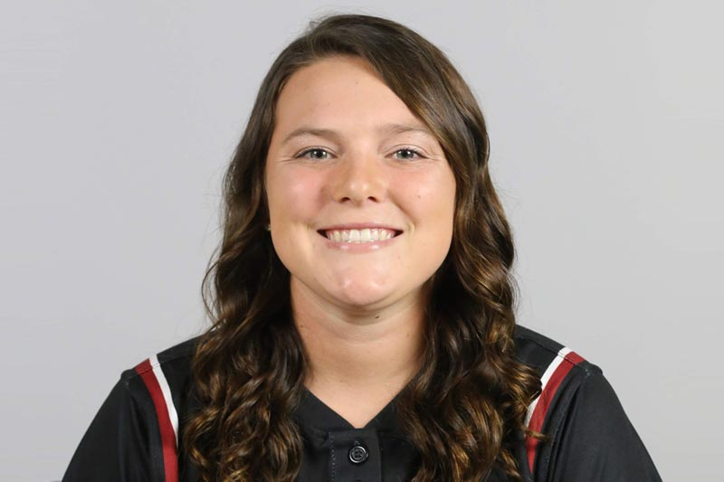 Profile photo of Charley Cox in her softball jersey