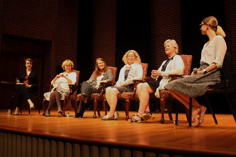 Panelists on stage during a discussion on social inequality