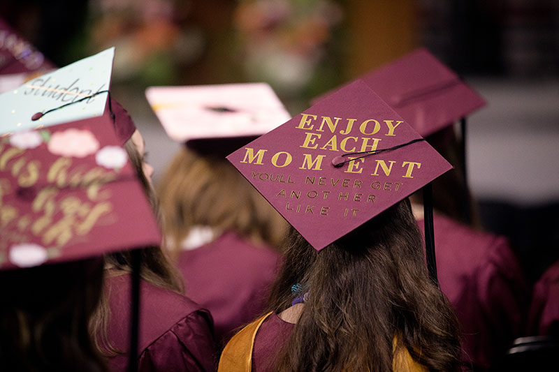 College Mortarboard with the words Enjoy Each Moment
