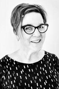 photo of Kiki Farish wearing glasses and black top - photo credit to Mercedes Jelinek
