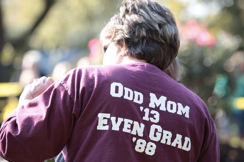 Parent in shirt that says Odd Mom '13 Even Grad '88