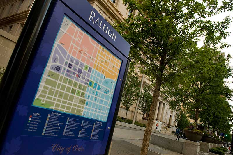 A blue kiosk with a map of downtown Raleigh