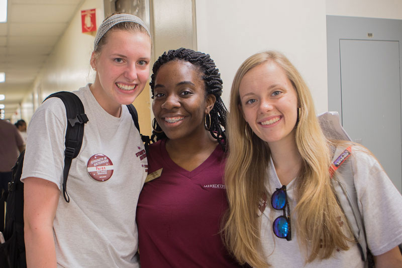 three students in residence hall