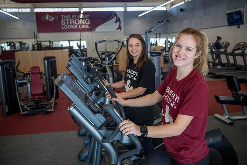 Two Meredith students on treadmills in the fitness center