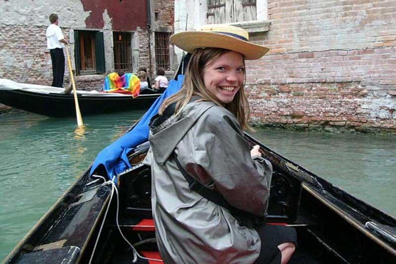 student in gondola in Italy