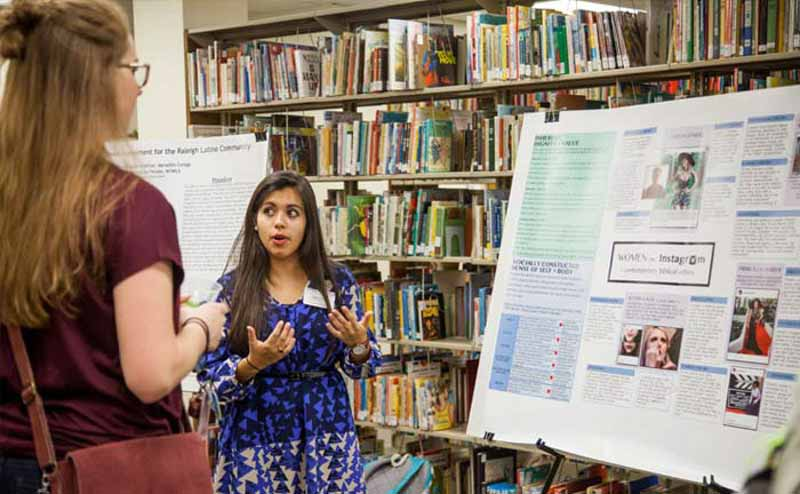 Student Presenting Project in Library