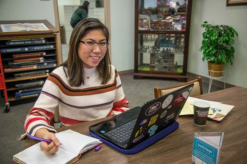Image of student studying with laptop open