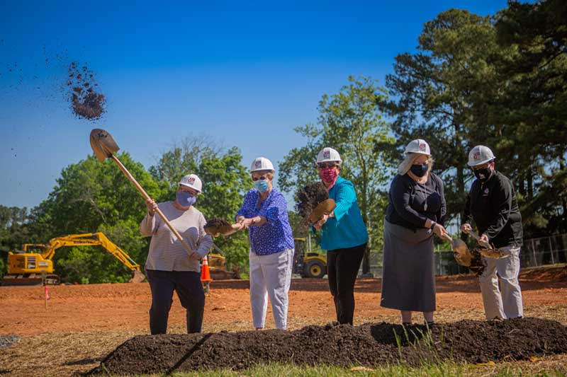 Five Meredith administrators with shovels
